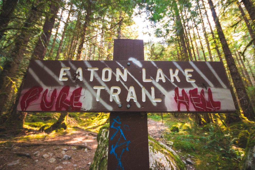 "Eaton Lake trail head sign that reads ""Pure Hell"""